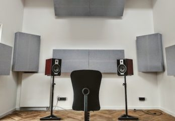 music studio with speakers, a chair and acoustic treatment